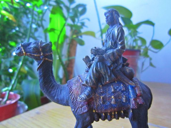 mini statue of a camel and its rider